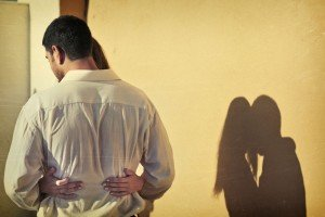 Romantic couple photo hugging heart shadow by TripShooter's Athens photographer Andreas Stavropoulos