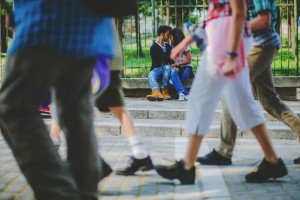 Couple kiss as people walk past by TripShooter's Athens photographer Andreas Stavropoulos