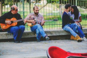 Couple and buskers with guitars by TripShooter's Athens photographer Andreas Stavropoulos