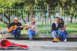 Couple embrace beside buskers with guitars by TripShooter's Athens photographer Andreas Stavropoulos
