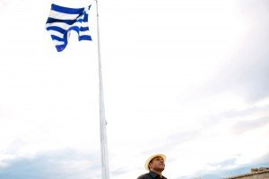 Trave man with Greek flags and hat by TripShooter's Athens photographer Andreas Stavropoulos
