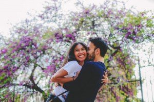 Couple kissing with purple flowers by TripShooter's Athens photographer Andreas Stavropoulos