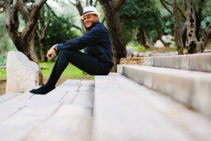 Happy man with hat sitting on steps by TripShooter's Athens photographer Andreas Stavropoulos