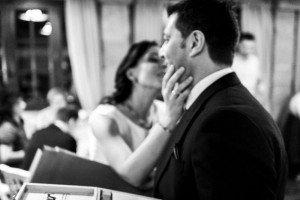 Bride kissing groom by TripShooter's photographer in Santiago de Compostela, Bertolino Matteo