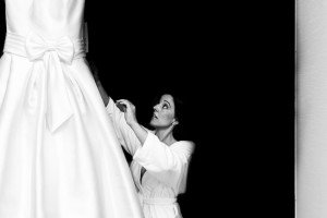 Bride looking at wedding dress, by TripShooter's photographer in Santiago de Compostela, Bertolino Matteo