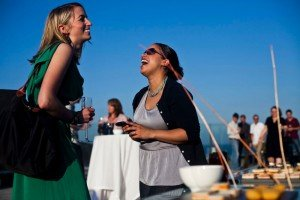 Women laughing with drinks, by Ramon Fornell photographer in Barcelona