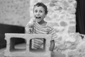 Laughing boy in black and white, by Ramon Fornell photographer in Barcelona