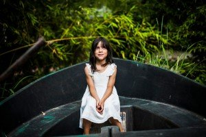 Little girl in white dress on boat, by Ramon Fornell photographer in Barcelona