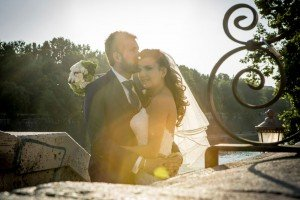 Married couple in Italy with sun flare by TripShooter Rome photographer Silvia Cleri
