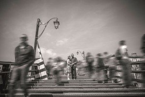 Photo of couple in moving crowd by TripShooter Venice photographer Jody Riva