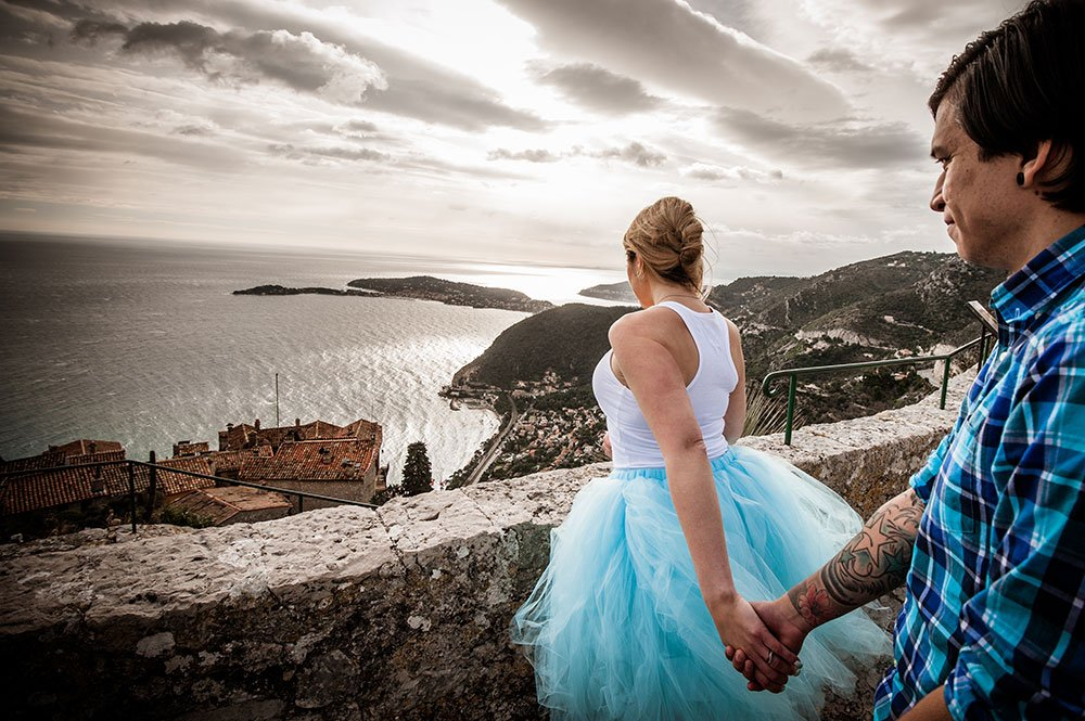 Woman leads man by the hand on travel adventure with romance, photo by TripShooter's French Riviera photographer Didier Ours