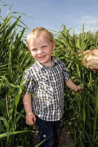 Portrait of happy boy in rushes, by TripShooter's photographer in Amsterdam, Adrienne Norman