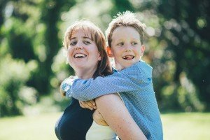 Photo portrait of mother and son in piggyback, by photographer for TripShooter, Dieter Decuypere