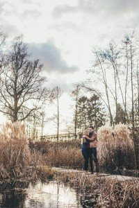 Couple portrait in winter grass landscape, by TripShooter's photographer in Brussels, Dieter Decuypere