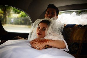 Bride and groom travel in car by TripShooter photographer in Paris Clara Abi Nadar
