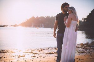 Husband and wife by seashore in marriage photo session, by Mont St Michel France photographer Frederic Renaud