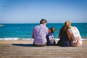 Family portrait on French vacation by Mont St Michel photographer Frederic Renaud