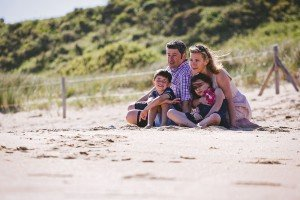 Family portrait in sand dunes in France, by Mont St Michel Normandy Brittany photographer Frederic Renaud