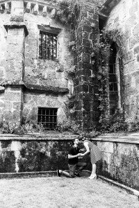 Couple marriage proposal in ancient architecture, at Santiago de Compostela by TripShooter photographer Matteo Bertolino