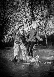 Couple jumping in puddles, by TripShooter's Edinburgh photographer Sean Bell
