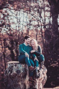 Happy couple in autumn forest, by TripShooter's Edinburgh photographer Sean Bell