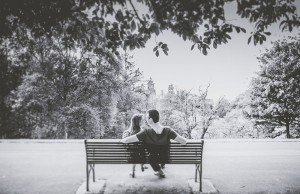 Couple relaxing on park bench black and white, by TripShooter's Edinburgh photographer Sean Bell