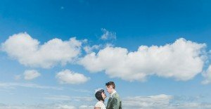 Married couple with blue sky and clouds at destination wedding, by TripShooter's Edinburgh photographer Sean Bell