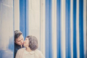 Couple kiss by striped wall, by TripShooter's Edinburgh photographer Sean Bell