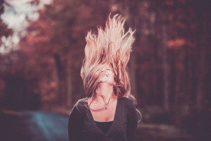 Woman in autumn whipping her hair, by TripShooter's Edinburgh photographer Sean Bell