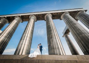 Married couple wedding portrait, sky and pillars, by TripShooter's Edinburgh photographer Sean Bell