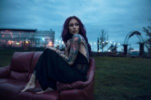 Fashion portrait of woman at city dusk, by TripShooter's Amsterdam photographer Radu Carnaru