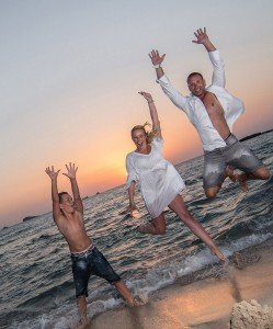 Happy family jump in beach photo, by TripShooter's Ibiza photographer Tamas Kooning