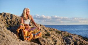 Fashion portrait of older woman by the sea, by TripShooter's Ibiza photographer Tamas Kooning