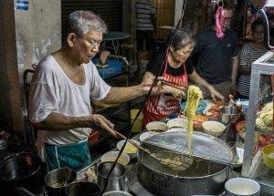 Photo of local cooks with noodles by London photographer Leyla Kazim