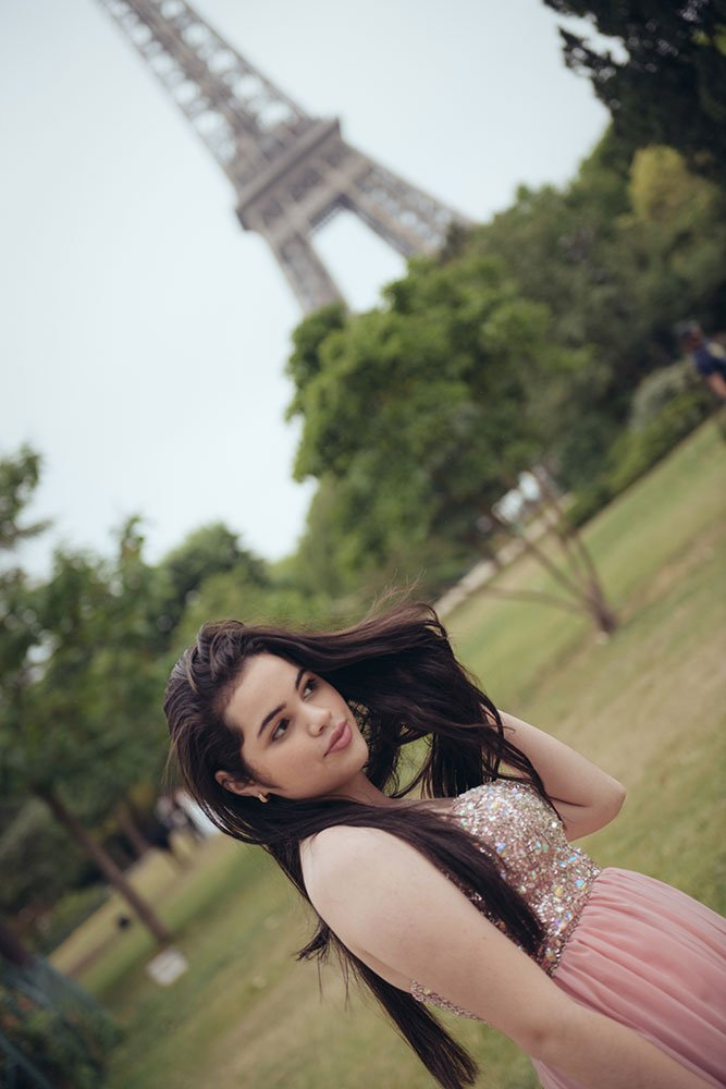 Feeling beautiful in a special quinceanera private photo shoot at the Eiffel Tower, by TripShooter's Paris photographer Jade Riviere