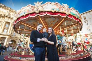 Family photo with carousel in Italy, by TripShooter's Florence photographer Dorin Vasilescu