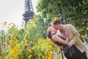 Romantic honeymoon photos in yellow flowers kissing by the Eiffel Tower, by Paris photographer Jade Riviere