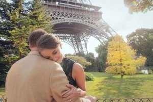Honeymoon couple embrace in romantic photos at Eiffel Tower with Paris photographer Jade Riviere