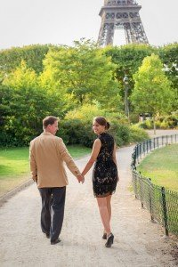 Sweet honeymoon photos walking hand in hand by the Eiffel Tower embracing, by Paris photographer Jade Riviere