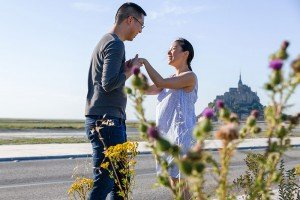 Beautiful marriage proposal portraits in Mont St Michel France with TripShooter photographer Frederic Renaud