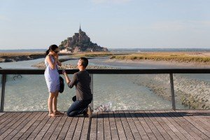 Photographs of a surprise marriage proposal in Mont St Michel France with TripShooter photographer Frederic Renaud