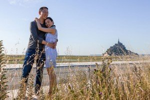 Couple portraits after surprise marriage proposal in Mont St Michel France with TripShooter photographer Frederic Renaud