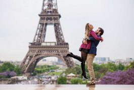 Photo of couple in love jumping at Eiffel Tower, photo by TripShooter's photographer in Paris, Christian Perona