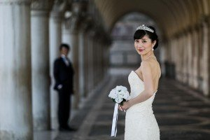 Wedding in Venice - bride and groom under arches - by TripShooter's Venice photographer Matteo Michelino