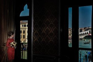 Beautiful photo portrait of woman in window by TripShooter's photographer in Venice Matteo Michelino