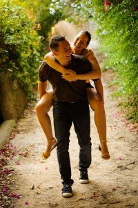 Happy couple explore on piggyback by TripShooter's Barcelona photographer Pablo Romero