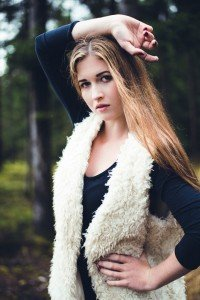 Fashion Portrait of woman wearing shaggy vest, by TripShooter's photographer in Vienna, Maria Harms