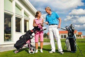 Golf travel couple by Stockholm photographer Gunta Podina