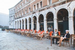 Couple dine on vacation in Italy by Venice photographer Martina Barbon