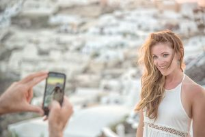 Natural and romantic vacation photo shoots in Santorini Greece by TripShooter's Santorini photographer Ioannis Pananakis